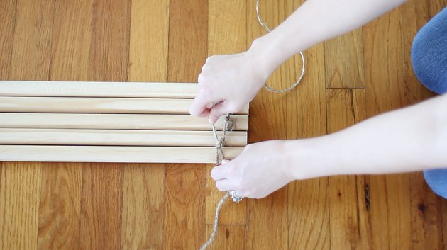 Tying a double knot around each dowel