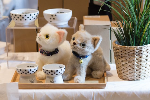 Two hand-crafted cat dolls on display at CatCon 2018.