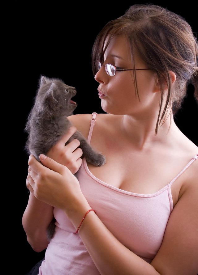 Young woman with kitten