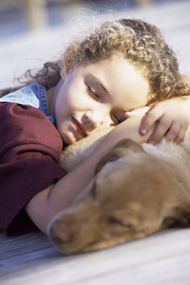 Close-up of a girl sleeping with her dog