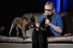 Carrie Fisher's Famous Dog, Gary, Is Caught In A Tug Of War But Not The Fun Kind