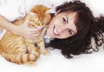Why Do Cats Sleep on Your Neck and Face?