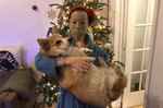 People Are Sharing Photos Of Themselves Lifting Dogs For A Mysterious Reason